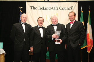 Henry McGarvey seen with Minister Martin Cullen, Honoree John Behan and Brian Goggin.