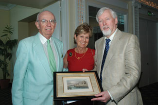 Mike & Cynthia Gibbons make a presentation to the Provost of Trinity College Dublin, Dr. John Hegarty.
