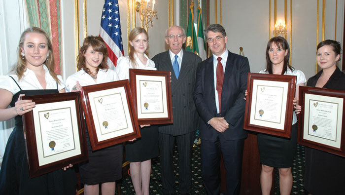 Ambassador Niall Burgess with Council President Mike Gibbons and this year's Council Scholarship Award Winners. From left: Nathalie Ennis, Helena Keenan, Anne Byrne, Elaine Stack and Sarah Conmy.