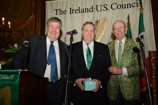 Frank Comerford is presented with the traditional crystal apple by President Swanson and Council President-Emeritus Mike Gibbons